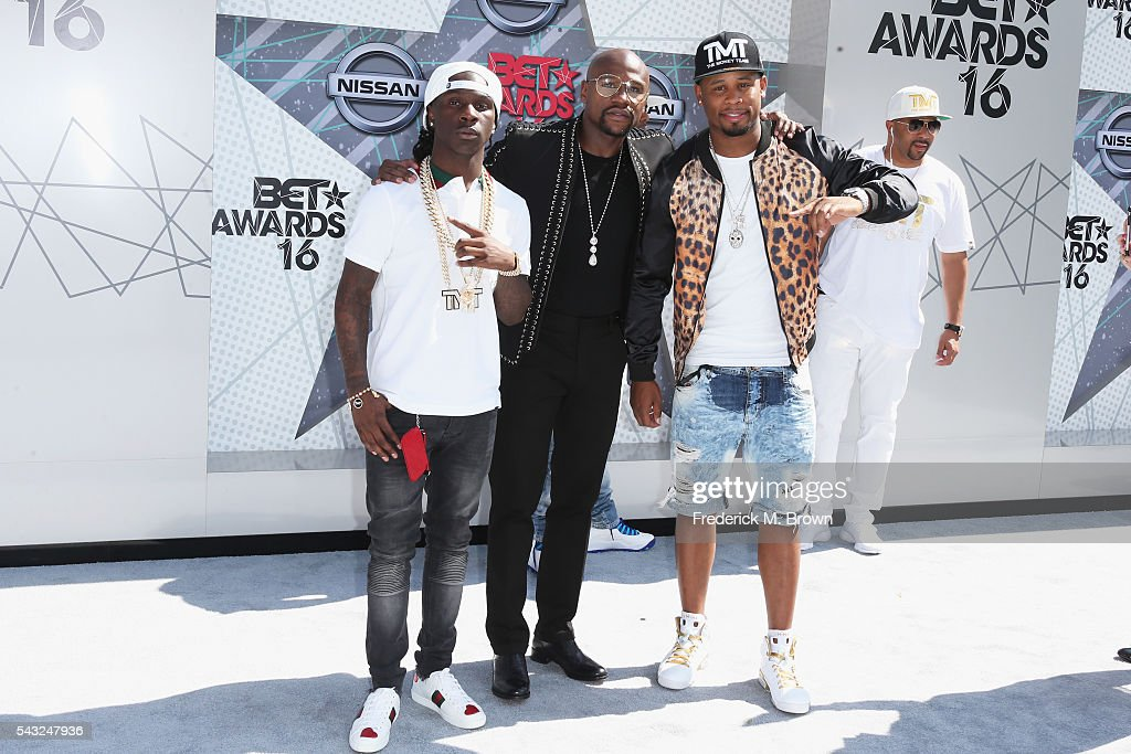 Professional boxer Floyd Mayweather (C) and guests attend the 2016 BET Awards at the Microsoft Theater on June 26, 2016 in Los Angeles, California.
