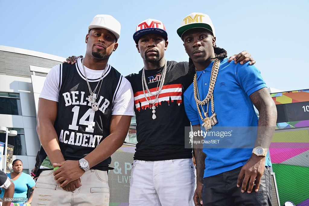 Professional boxer Floyd Mayweather (C) and recording artist Lil Jamez (R) pose onstage at 106 & Park Sponsored by Coca-Cola during the 2016 BET Experience on June 25, 2016 in Los Angeles, California.