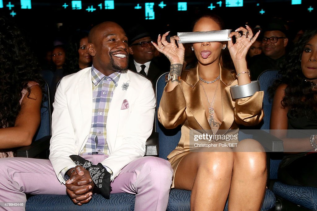 Professional boxer Floyd Mayweather, Jr. (L) and recording artist Rihanna (holding a piece of duct tape) attend the 2015 BET Awards at the Microsoft Theater on June 28, 2015 in Los Angeles, California.