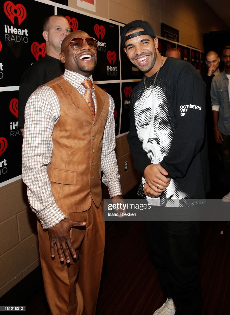 Professional boxer Floyd Mayweather Jr. (L) and singer Drake attend the iHeartRadio Music Festival at the MGM Grand Garden Arena on September 21, 2013 in Las Vegas, Nevada.