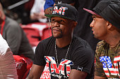 Professional boxer Floyd Mayweather watches as the Houston Rockets face the Golden State Warriors during the 2016 Las Vegas Summer League on July 13...