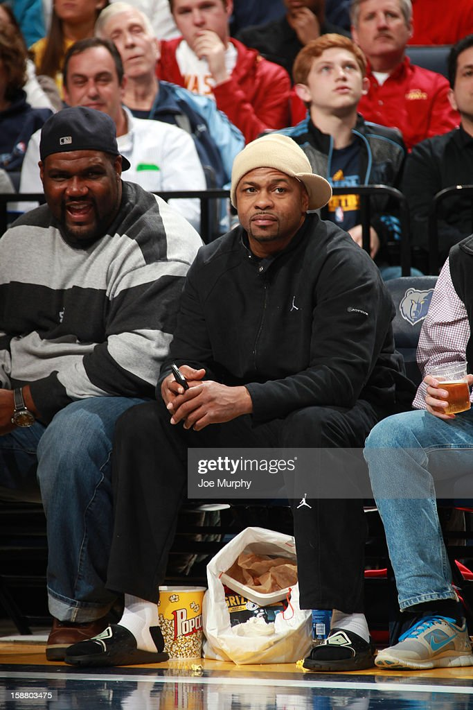 Professional boxer, Roy Jones, Jr. (R) watches a game between the Memphis Grizzlies and the Denver Nuggets on December 29, 2012 at FedExForum in Memphis, Tennessee.
