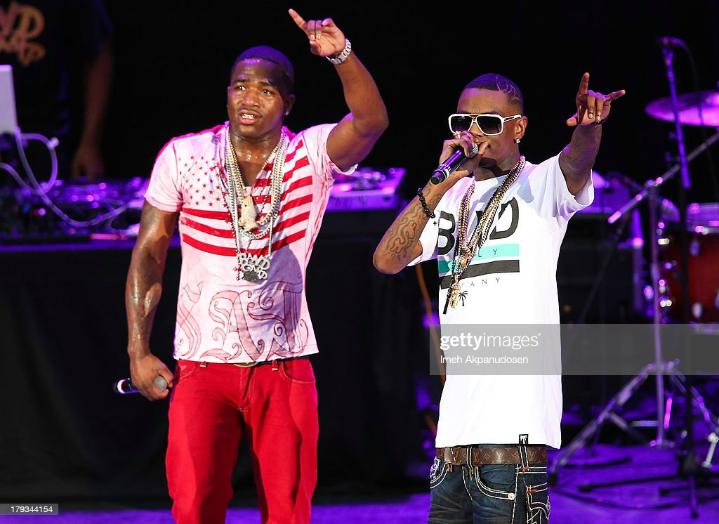Professional boxer/rapper Adrien Broner (L) and rapper <a gi-track='captionPersonalityLinkClicked' href=/galleries/search?phrase=Soulja+Boy&family=editorial&specificpeople=4411462 ng-click='$event.stopPropagation()'>Soulja Boy</a> perform during the 2013 America's Most Wanted Musical Festival at Verizon Wireless Amphitheatre on September 1, 2013 in Laguna Hills, California.