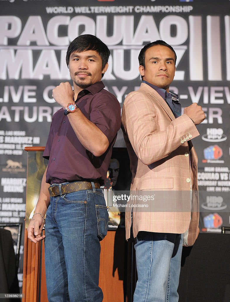 Professional Boxers <a gi-track='captionPersonalityLinkClicked' href=/galleries/search?phrase=Manny+Pacquiao&family=editorial&specificpeople=3855506 ng-click='$event.stopPropagation()'>Manny Pacquiao</a> (L) and <a gi-track='captionPersonalityLinkClicked' href=/galleries/search?phrase=Juan+Manuel+Marquez&family=editorial&specificpeople=4202669 ng-click='$event.stopPropagation()'>Juan Manuel Marquez</a> attend the press conference for their World Welterweight Championship Fight at The Lighthouse at Chelsea Piers on September 6, 2011 in New York City.