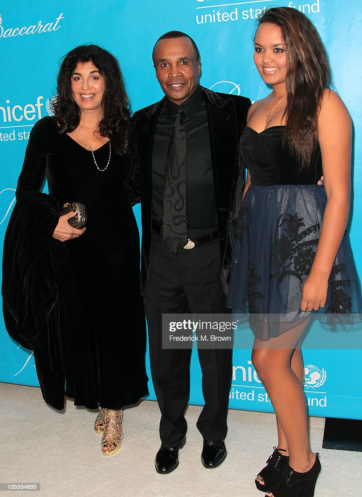 Professional boxing champion <a gi-track='captionPersonalityLinkClicked' href=/galleries/search?phrase=Sugar+Ray+Leonard&family=editorial&specificpeople=206479 ng-click='$event.stopPropagation()'>Sugar Ray Leonard</a> (C) and his family attend The 2011 Unicef Ball at The Beverly Wilshire Hotel on December 8, 2011 in Beverly Hills, California