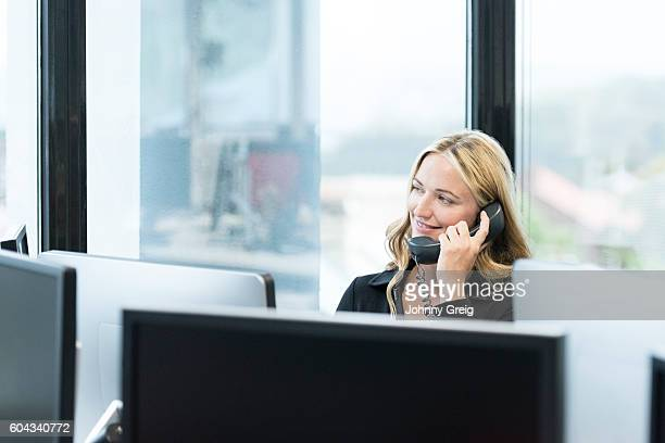 Professional business manager on telephone in office