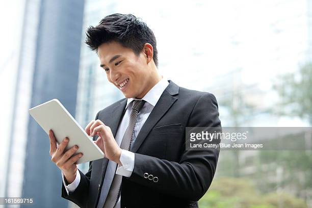 Professional businessman with digital tablet, Hong Kong