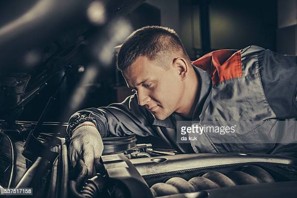 Professional car mechanic working in auto repair service