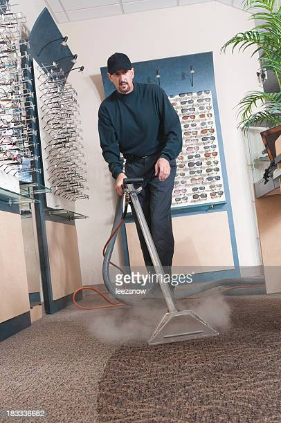 A professional carpet cleaner at work