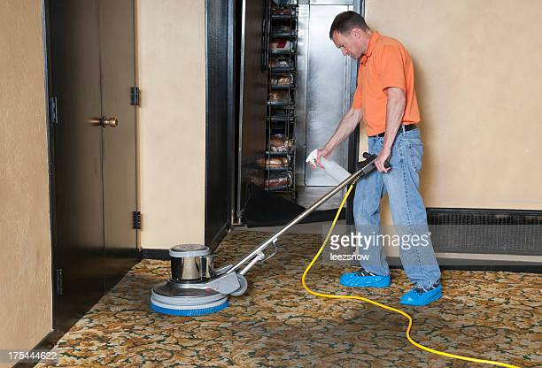 A professional carpet cleaner cleaning the hallway