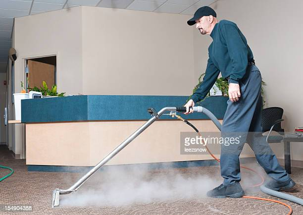 Professional Carpet Cleaner - Man Steam Cleaning