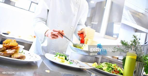 Professional chef cooking in restaurant kitchen.