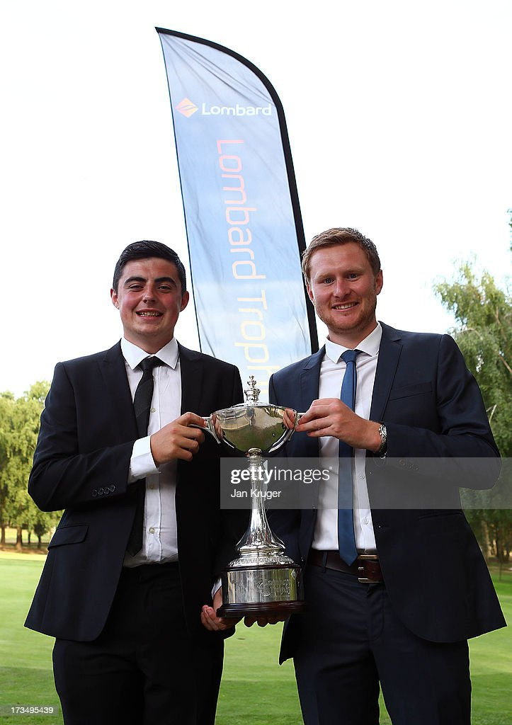 Professional Chris Smith of Fynn Valley GC (R) and amateur partner Kane Mayes pose after posting the winning score during The Lombard Trophy Regional Qualifier at King's Lynn Golf Club on July 15, 2013 in King's Lynn, England.