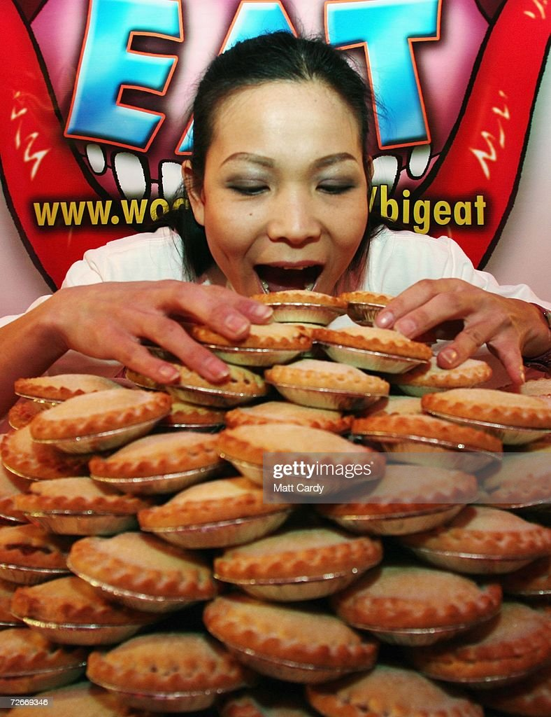 Professional competitive eater Sonya Thomas, aka 'The Black Widow', poses for photographs before entering the Wookey Hole Big Eat Mince Pie Eating Contest, at the Wookey Hole Show Caves on November 29, 2006 in Wookey Hole, near Wells, England. Twelve handpicked competitors, professionals and members of the public alike, will attempt to eat as many mince pies as possible in the space of 10 minutes.
