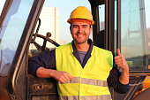 Professional construction industry driver giving thumbs up.