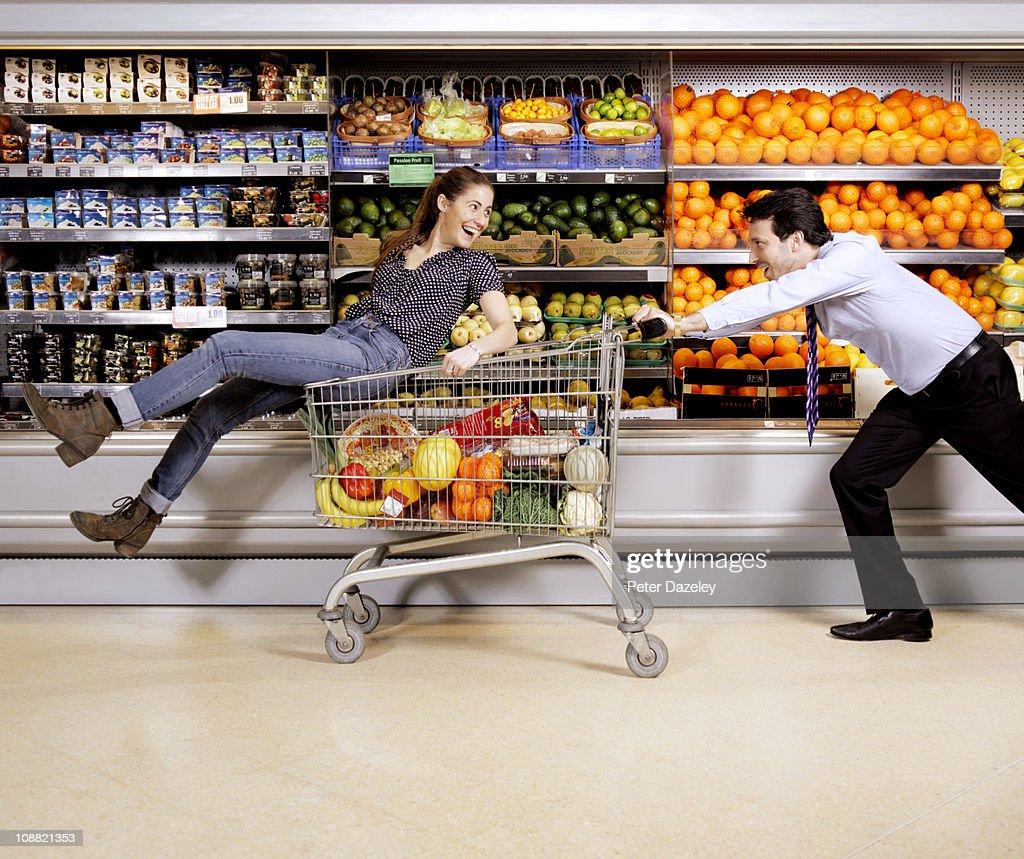 Professional couple having fun in supermarket : Stock Photo