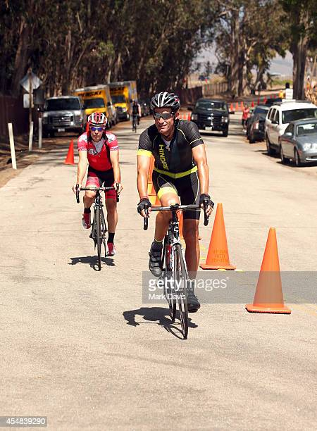 Professional cyclist George Hincapie crosses the finish line of the Best Buddies Challenge Hearst Castle at Hearst Ranch on September 6 2014 in San...