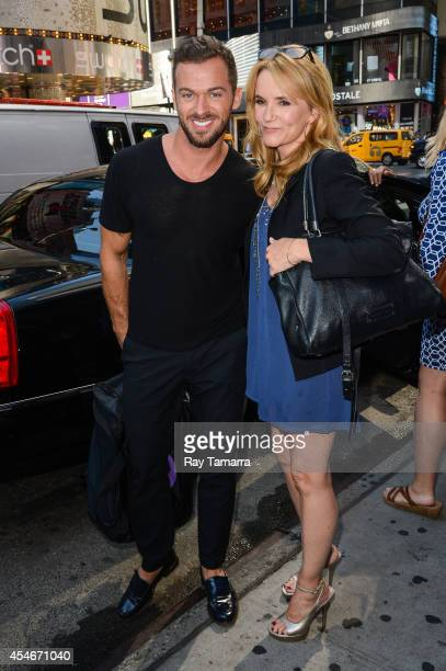Professional dancer Artem Chigvintsev and actress Lea Thompson leave Planet Hollywood Times Square on September 4 2014 in New York City