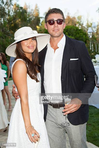 Professional dancer Cheryl Burke and NHL player Joffrey Lupul attend Jockey For A Cause on July 18 2012 in Los Angeles California