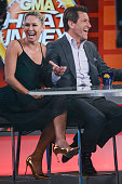Professional dancer Kym Johnson and television personality Robert Herjavec tape an interview at 'Good Morning America' at the ABC Times Square...