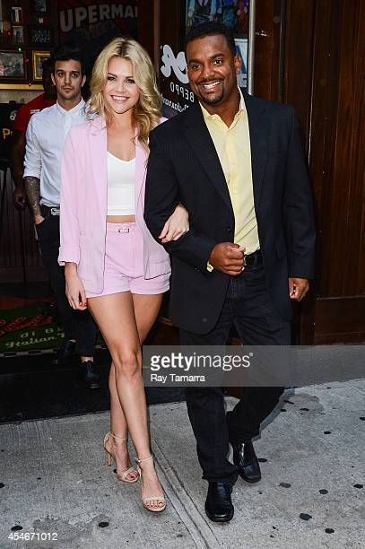 Professional dancer Witney Carson and actor Alfonso Ribeiro leave Planet Hollywood Times Square on September 4 2014 in New York City