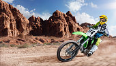 Brave professional dirt bike riders racing on the track