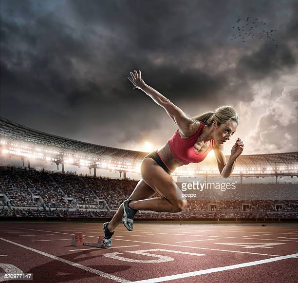 Professional Female Athlete Sprinting Off Blocks