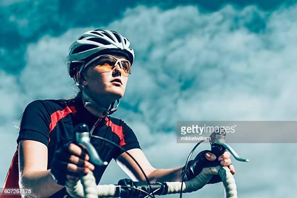 Professional female bike rider rides bicycle