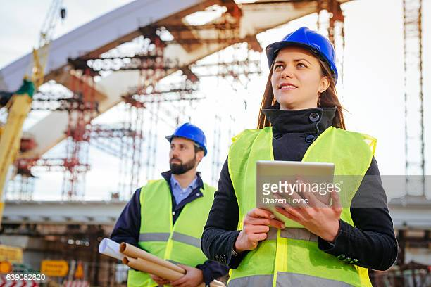 Professional female engineer using laptop on construction site