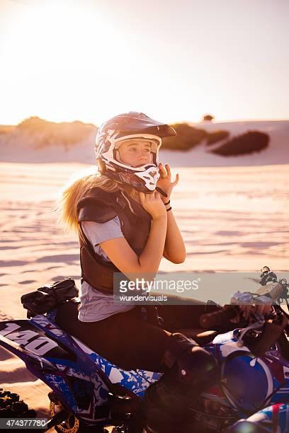 Professional female quad bike racer on her four-wheeler