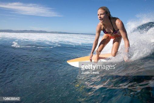 Professional female surfer at Cloud Break Fiji : Stock Photo