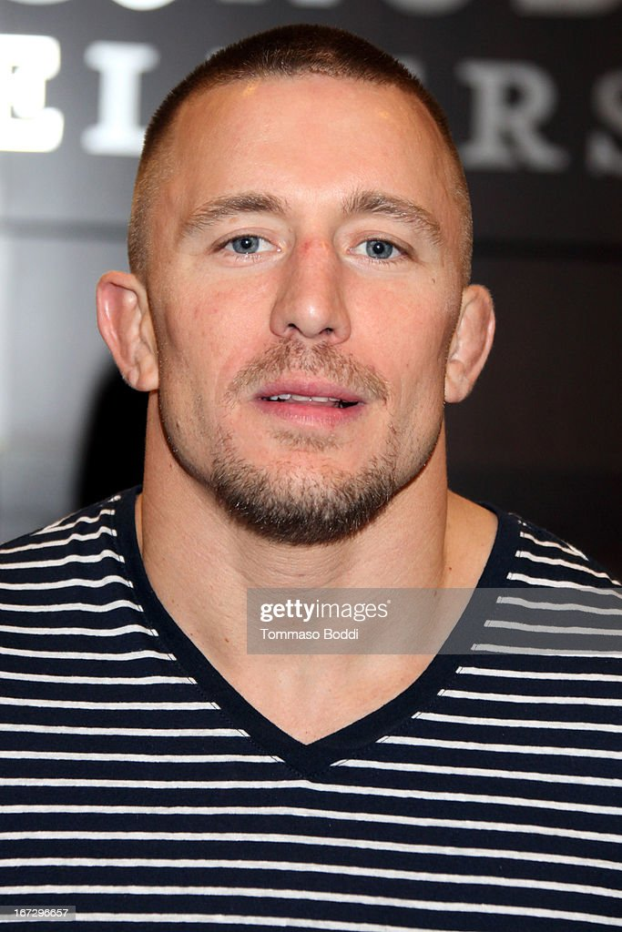 Professional fighter <a gi-track='captionPersonalityLinkClicked' href=/galleries/search?phrase=Georges+St-Pierre&family=editorial&specificpeople=4864241 ng-click='$event.stopPropagation()'>Georges St-Pierre</a> signs copies of his new book 'The Way Of The Fight' at Barnes & Noble bookstore at The Grove on April 23, 2013 in Los Angeles, California.