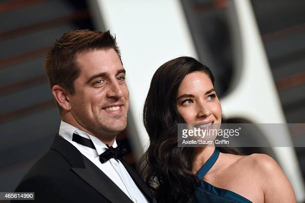 Professional football player Aaron Rodgers and actress Olivia Munn arrive at the 2015 Vanity Fair Oscar Party Hosted By Graydon Carter at Wallis...