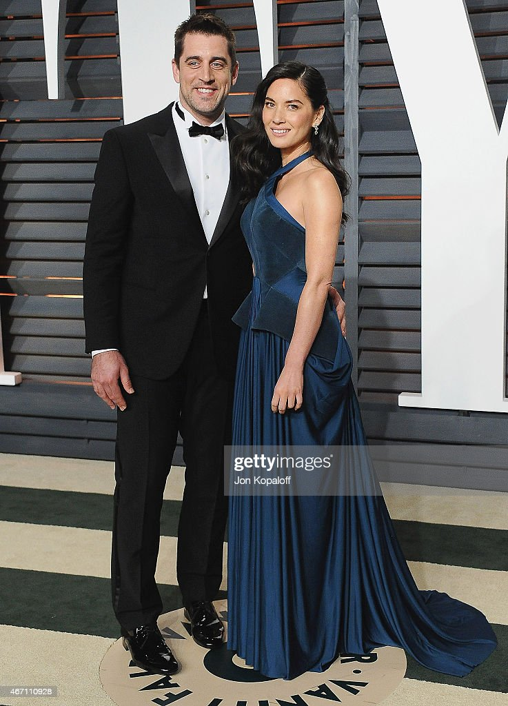 Professional football player Aaron Rodgers and actress Olivia Munn arrive at the 2015 Vanity Fair Oscar Party Hosted By Graydon Carter at Wallis Annenberg Center for the Performing Arts on February 22, 2015 in Beverly Hills, California.