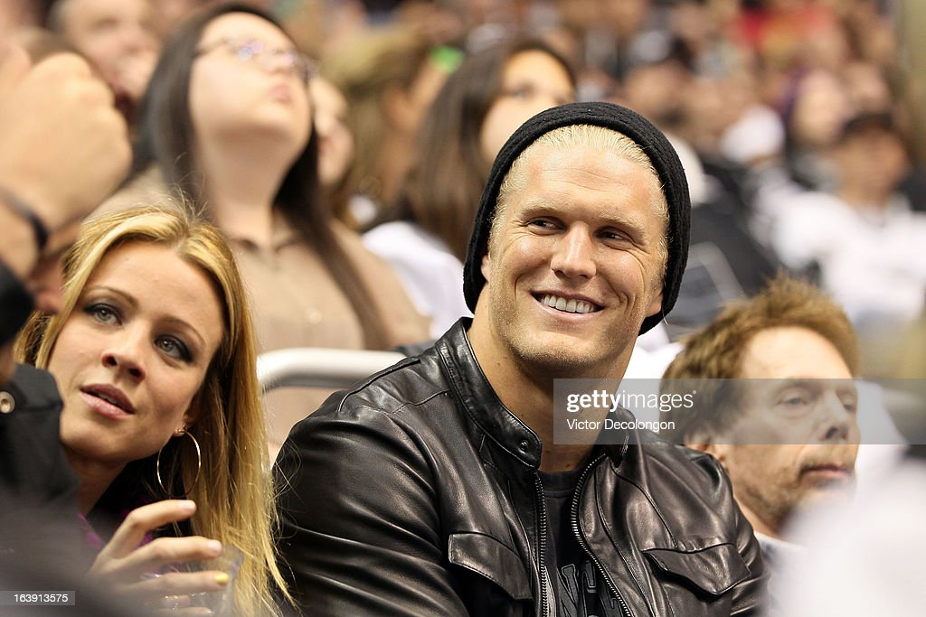 Professional football player Clay Matthews of the Green Bay Packers (R)attends the NHL game between the San Jose Sharks and the Los Angeles Kings at Staples Center on March 16, 2013 in Los Angeles, California. The Kings defeated the Sharks 5-2.