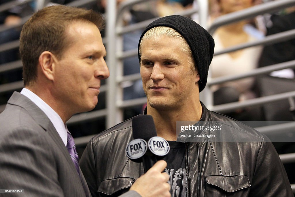 Professional football player Clay Matthews of the Green Bay Packers (R) speaks with FOX Sports sportscaster Patrick O'Neal during the NHL game between the San Jose Sharks and the Los Angeles Kings at Staples Center on March 16, 2013 in Los Angeles, California. The Kings defeated the Sharks 5-2.