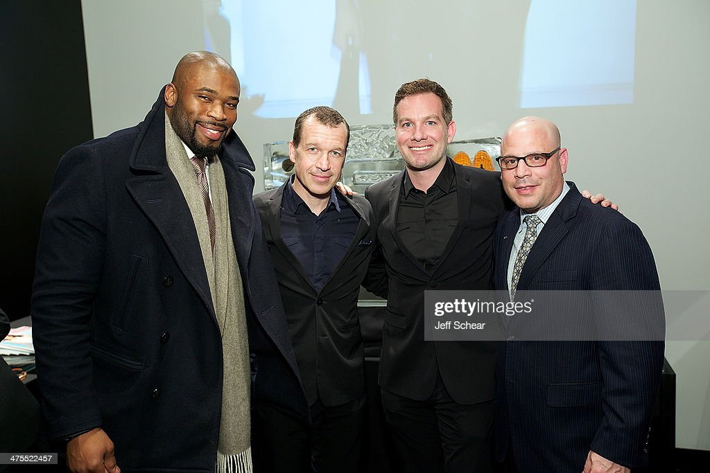Professional football player Israel Idonije CEO of Porsche Design Group Juergen Gessler Justin Pauly and President and Publisher of Michigan Avenue...