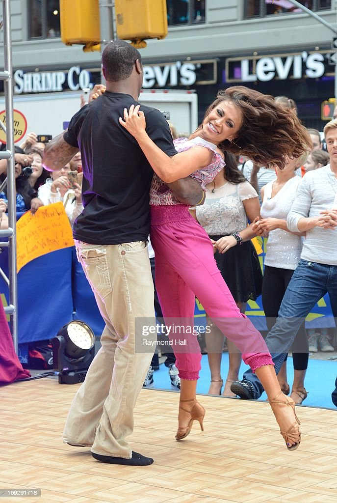 Professional football player Jacoby Jones (L) and TV personality Karina Smirnoff perform at the 'Good Morning America' taping at the ABC Times Square Studios on May 22, 2013 in New York City.