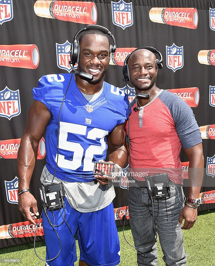 Professional football player Jonathan Beason (L) and actor Taye Diggs attend a Duracell interactive tour of MetLife Stadium on August 27, 2014 in East Rutherford, New Jersey.