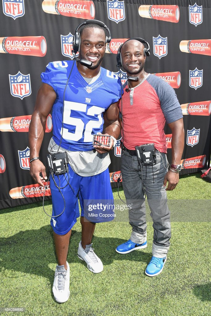 Professional football player Jonathan Beason and actor Taye Diggs attend an interactive tour of MetLife Stadium on August 27 2014 in East Rutherford...