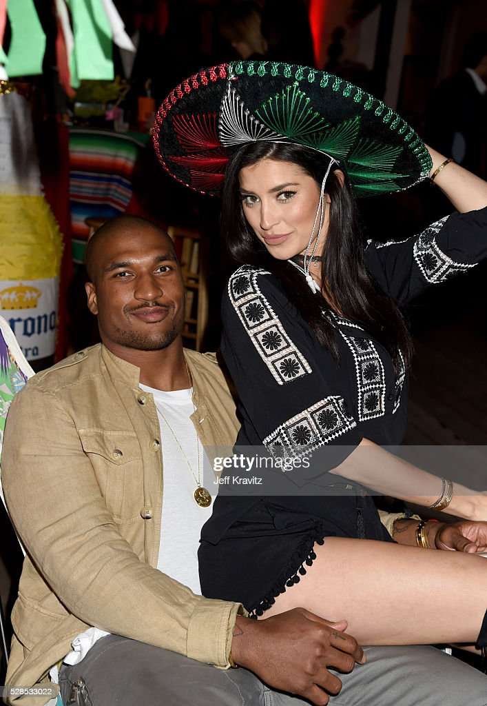 Professional football player Larry English and TV personality Nicole Williams attend the Hale Bob Fiesta on May 5 2016 in Beverly Hills California