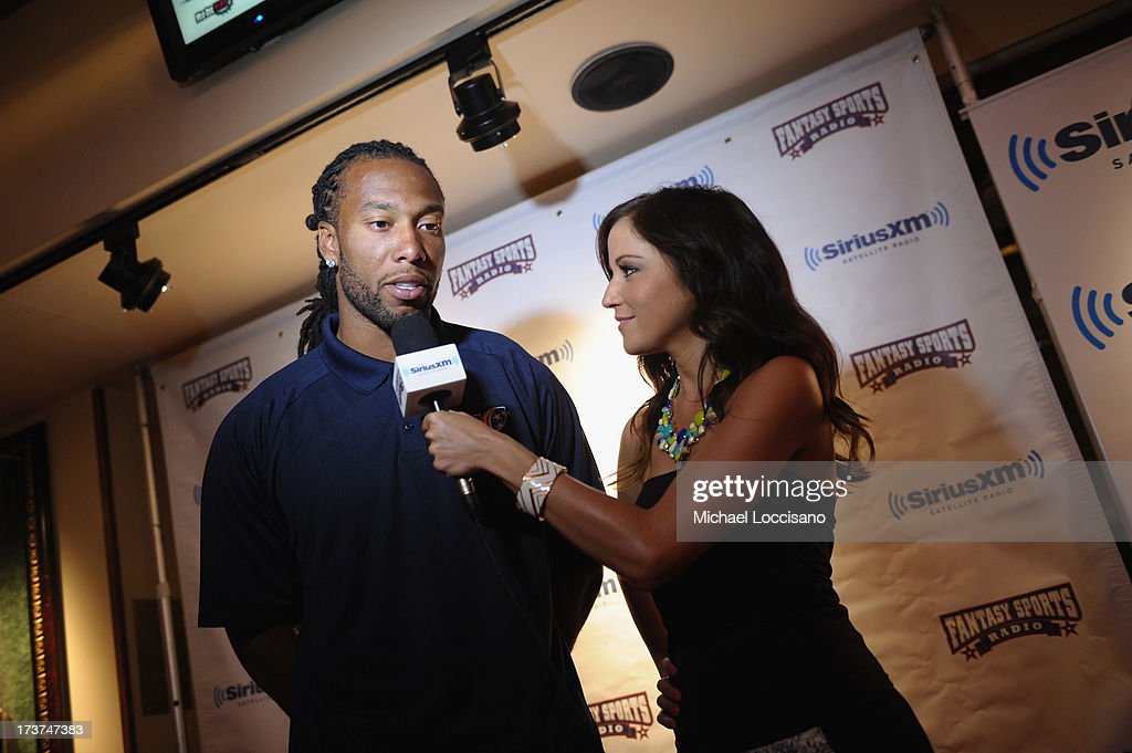 Professional Football player <a gi-track='captionPersonalityLinkClicked' href=/galleries/search?phrase=Larry+Fitzgerald&family=editorial&specificpeople=183380 ng-click='$event.stopPropagation()'>Larry Fitzgerald</a> and SiriusXM radio host Kay Adams attend the SiriusXM Celebrity Fantasy Football Draft at Hard Rock Cafe - Times Square on July 17, 2013 in New York City.