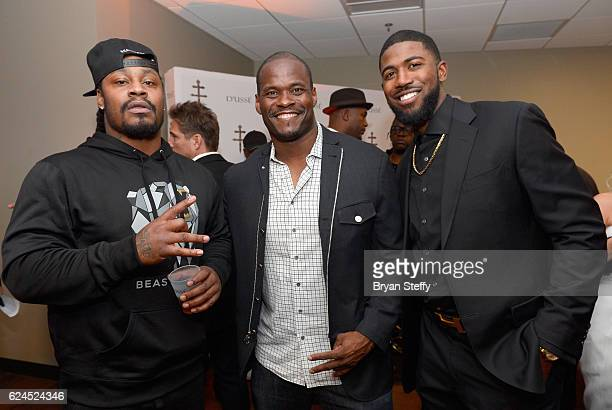 Professional football player Marsahwn Lynch professional football player Melvin Fowler and professional baseball player Dexter Fowler attend the...