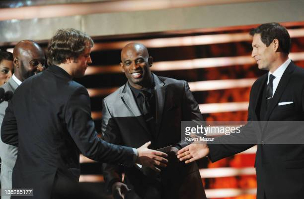 Professional Football Player Matthew Stafford and Former Professional Football Players Jerry Rice Deon Sanders and Steve Young speak during the 2012...