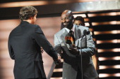 Professional Football Player Matthew Stafford and Former Professional Football Player Jerry Rice speak during the 2012 NFL Honors at the Murat...