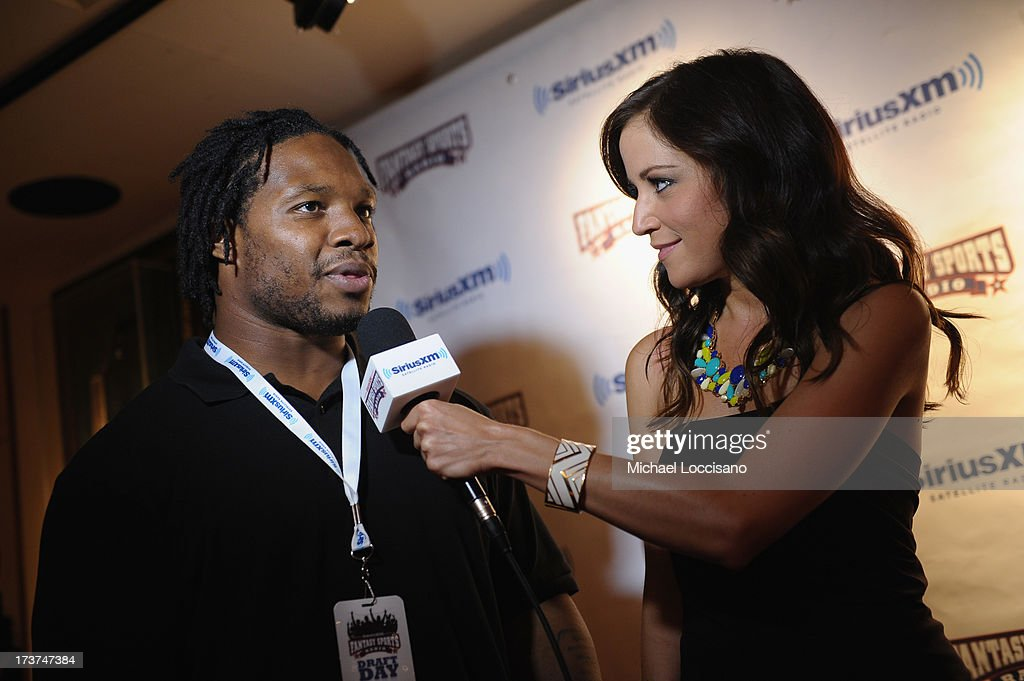 Professional Football player Maurice Jones-Drew and SiriusXM radio host Kay Adams attend the SiriusXM Celebrity Fantasy Football Draft at Hard Rock Cafe - Times Square on July 17, 2013 in New York City.