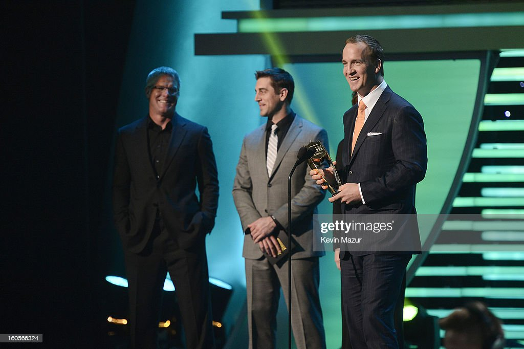 Professional football player Peyton Manning (R) speaks onstage as Brett Favre (L) and Aaron Rodgers (C) look on at 2nd Annual NFL Honors at the Mahalia Jackson Theater on February 2, 2013 in New Orleans, Louisiana.