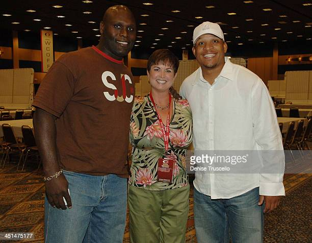 Professional football player Ricardo McDonald Claudia Rodriguez and professional football player Harry Colon attend the 2008 World Championship of...