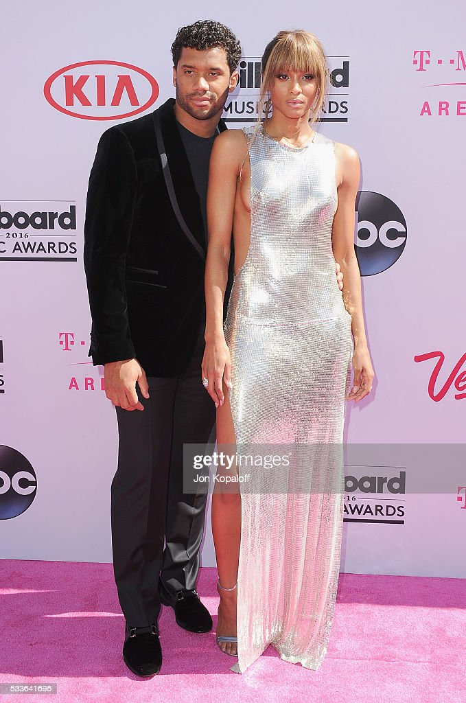 Professional football player Russell Wilson and singer Ciara arrive at the 2016 Billboard Music Awards at TMobile Arena on May 22 2016 in Las Vegas...