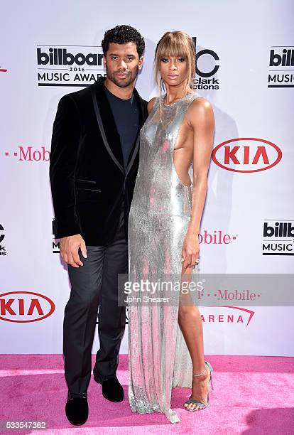 Professional football player Russell Wilson and singer Ciara attend the 2016 Billboard Music Awards at TMobile Arena on May 22 2016 in Las Vegas...